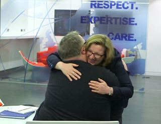 Client hug at reception