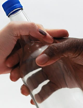 hands giving bottle of help