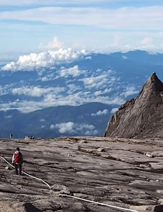 People climbing mountain with sky view