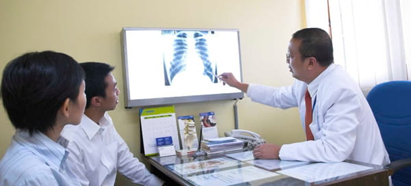 Doctor pointing at lung x-ray