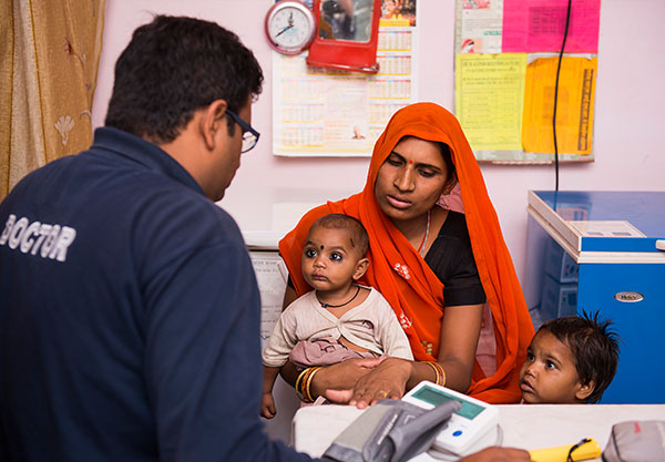 Dr. Sanket Patel at clinic talking to family